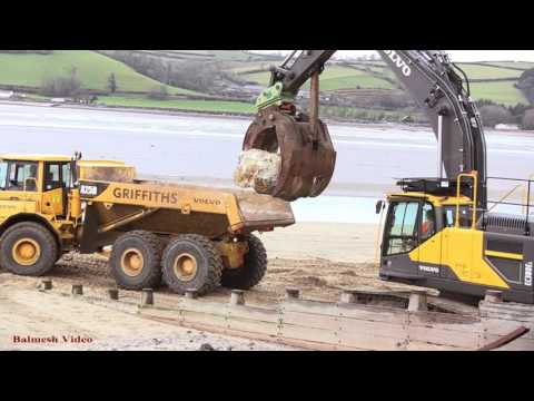 Ferryside Sea Defences - Rock-Moving by Dump Truck.  Loading by 360.