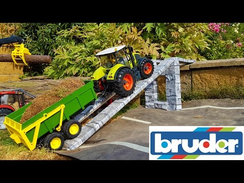 RC BRUDER tractor Claas Axion rides through Bruder village