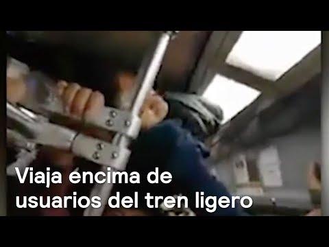Joven viaja por encima de usuarios del tren ligero en CDMX - Las Noticias Con Danielle
