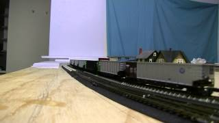 N scale empty BNSF coal train runs through Highland Jcnt