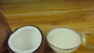 Pan shot of tropical coconuts with products made from coconut - loopable fruit