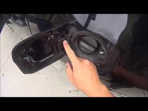 Cheap, easy fix for a broken spring on Gas cap Fuel Filler Door repair