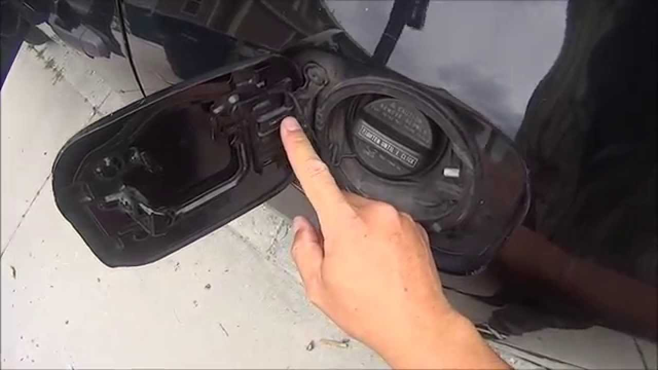 small resolution of cheap easy fix for a broken spring on gas cap fuel filler door repair youtube