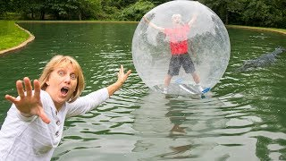 MONSTER IN POND TRAPPED INSIDE GIANT BUBBLE BALL