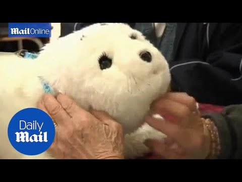 robot-baby-seal-'paro'-helps-elderly-dementia-patients-in-hong-kong---daily-mail