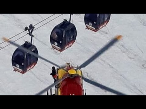 Rescuers save cable car passengers trapped in French Alps