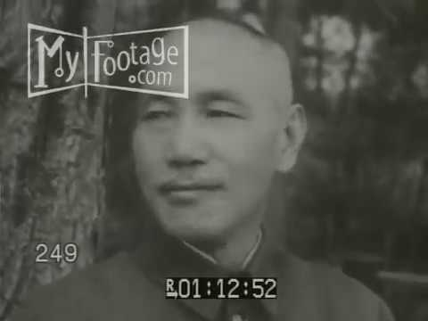 Stock Footage - CHIANG KAI-SHEK. SOVIET STYLE RED FLAG WAVES IN CHINESE HARBOR