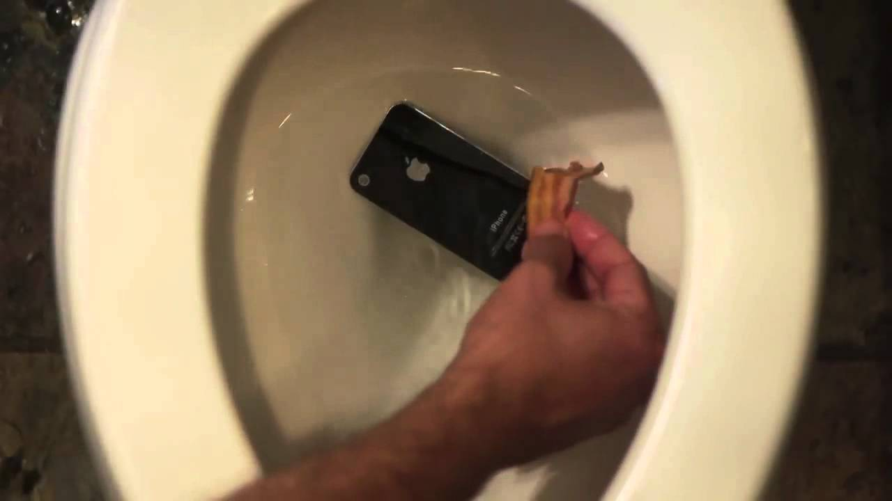 HIDDEN: iPhone in a Toilet  - A hidden behind the scenes video showing an iPhone being thrown into a toilet bowl.  The video is linked to from the comedy music video 'Rub Some Bacon on It'.