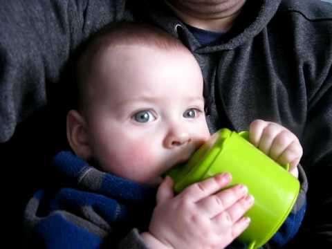 baboo has mommy's milk from cup.mp4
