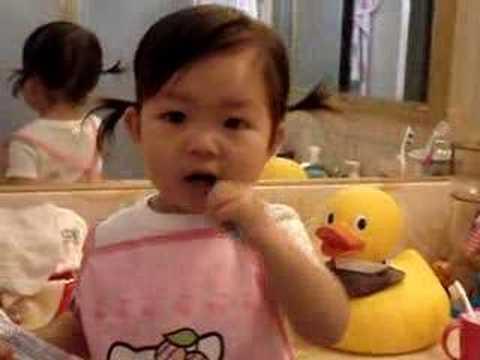 Kung Fu baby brushing her teeth