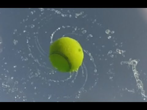Wet spinning tennis ball - science in motion