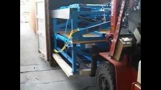 Loading Woodworking Machinery Into Shipping Container