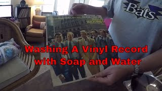 cleaning records with soap and water