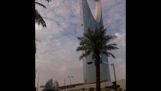 kingdom tower mamlika under dark clouds olaya king fahad road riyadh saudi arabia 21