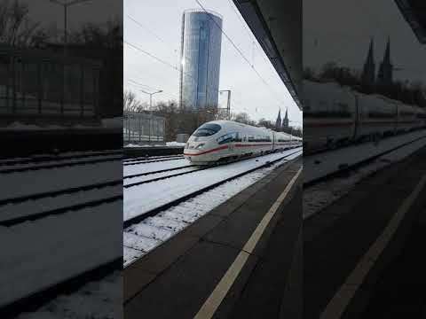ICE Train Going Through Cologne Deutz Station In Snow