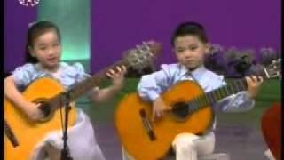 [гитары] «В нашем доме много  смеха» {Музыка КНДР}