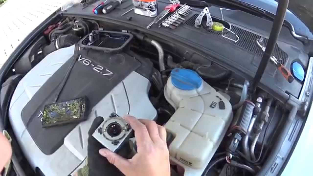 Wymiana palnika Xenon Audi A6 C6 - YouTube
