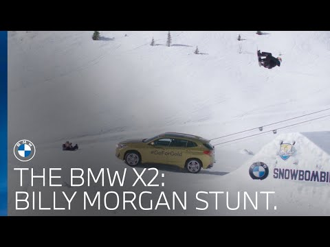 Olympic snowboarder Billy Morgan jumps over a brand new BMW X2.