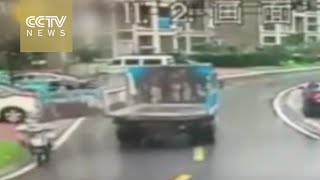Father and daughter on e-bike struck by truck's swinging tailgate