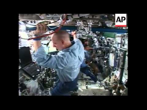 unfolding-of-solar-rays-on-space-station,-ground-control-reax