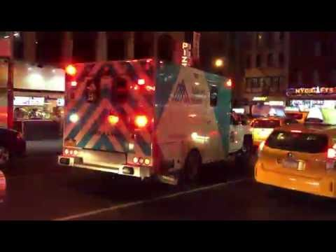 MOUNT SINAI WEST HOSPITAL EMS AMBULANCE RESPONDING IN HEAVY TRAFFIC IN MIDTOWN, MANHATTAN, NEW YORK.