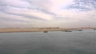 مشهد عام للحفر بقناة السويس الجديدة من الضفة الشرقية للقناة الحالية
