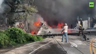 Tanker truck crashes into building & erupts in flames in Honduras, driver killed