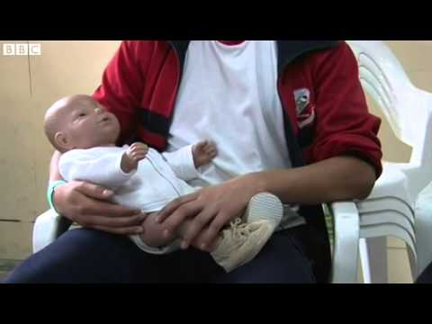 Robotic babies aim to cut teen pregnancy in Bogota