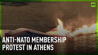 Anti-NATO membership protesters burn US and alliance flags near American embassy in Athens