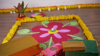Bokeh shot of a beautiful rangoli with colorful gift boxes on the occasion of Diwali