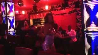 Former Pussycat Doll Asia Nitollano dances at Sushi Roxx