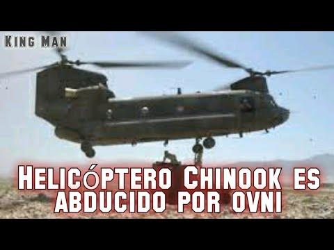 Helicóptero militar siendo abducido por un OVNI