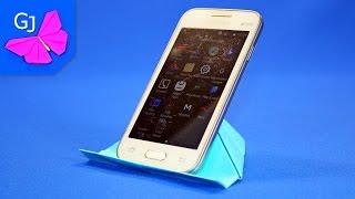 Оригами подставка под смартфон(Полезная бумажная поделка — оригами подставка под ваш смартфон. Сделать ее просто, а бумагу можно подобрат..., 2015-06-07T09:16:51.000Z)