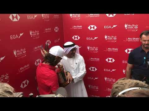 Tommy Fleetwood receiving the 2018 Abu Dhabi HSBC Golf Championship trophy