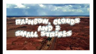 Rainbow, clouds and 2 small strikes