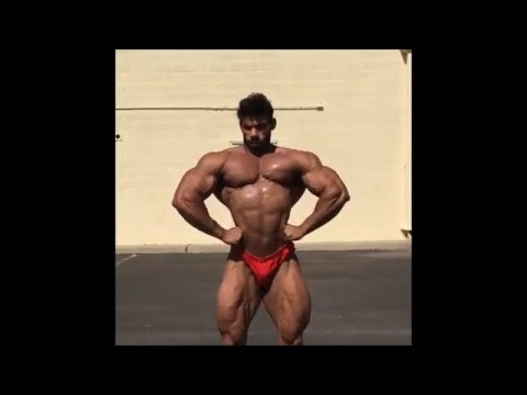 Arab bodybuilder Issa Al Hasni outdoor posing