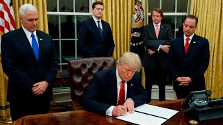 President Trump signs fiŗst executive orders
