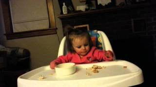 13 month old puts food in and out of bowl
