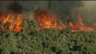 Apple Fire burns near the city of Beaumont in Riverside County