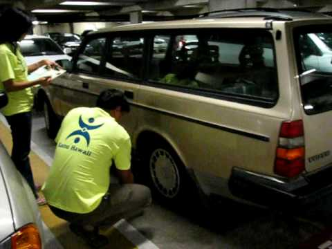 Kanu Hawaii service project checking tire pressure for lawmakers and staff