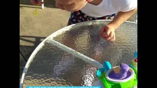 Eric brother with autism partial trisomy 15 syndrome and buzz Lightyear bubble machine June 29 2016