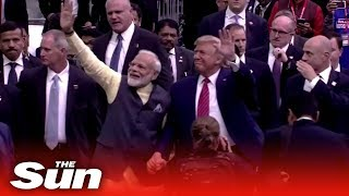 """Howdy Modi!"" -  Donald Trump hosts Indian Prime Minister Narendra Modi at Texas rally"