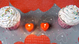 Top view shot of frosted cupcakes with heart-shaped candles - Valentine's day