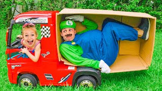 Maya and Mary build playhouses with parents