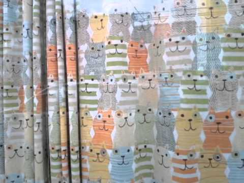 Pictures of cats on large curtains