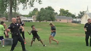 Video Albuquerque police challenge summer camp kids to water balloon fight download MP3, 3GP, MP4, WEBM, AVI, FLV Desember 2017