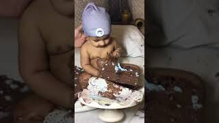 Funny Cute baby eating a cake