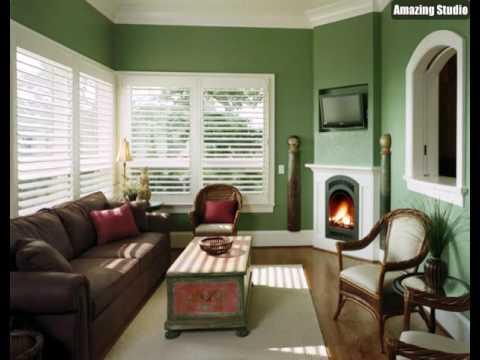 Grüne Wandfarbe Weiße Jalousien Hölzerne Möbel