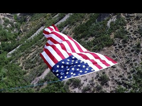 Massive U.S. flag hung between canyon walls in Pleasant Grove, Utah - July 4, 2015 - TEASER