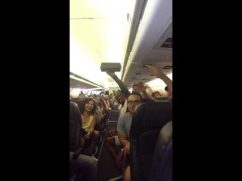 "Stranded Airline Passengers, Crazy From Heat And Boredom, Start Singing ""I Believe I Can Fly"""